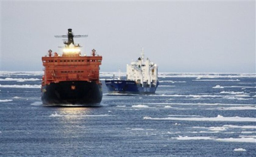 In this photo released by Beluga Shipping on Friday, Sept. 11, 2009, a pair of German merchant ships are seen as they traverse the fabled Northeast Passage. Two German ships have traversed the fabled Northeast Passage, having arrived in Siberia from South Korea by traveling around Russia's Arctic coast line. Global warming and melting ice made the journey possible. (AP Photo/Beluga Shipping)