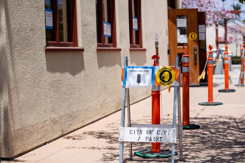 Signs following COVID-19 protocols at the entrance of the Finance Department at Chula Vista City Hall May 19.