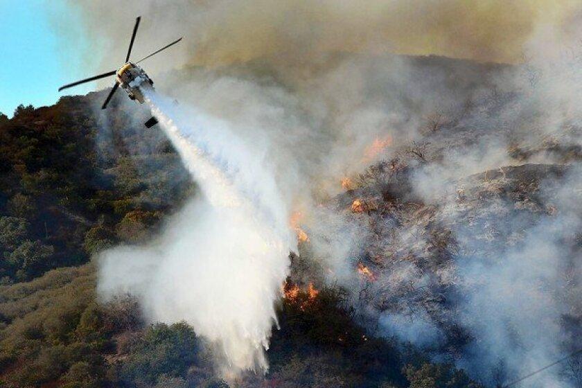Sepulveda Pass brush fire snarls traffic; Getty Center evacuated