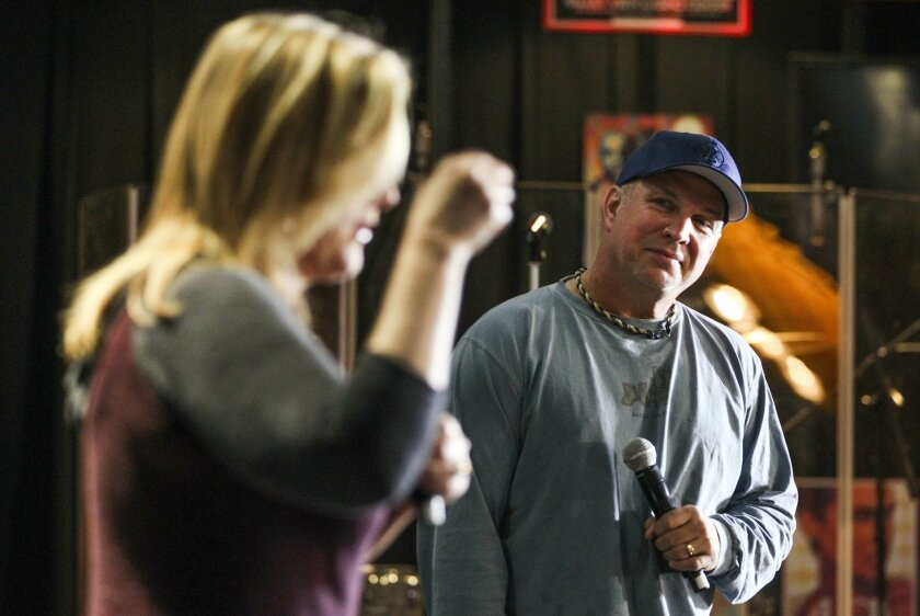 SAN DIEGO, CA, NOVEMBER 5, 2015 | Country music superstar Garth Brooks watches his wife and fellow country music singing star Trisha Yearwood talk to members of the media during a press conference before Brooks' first of a  five concert series at the Valley View Casino Center in San Diego on Thursd