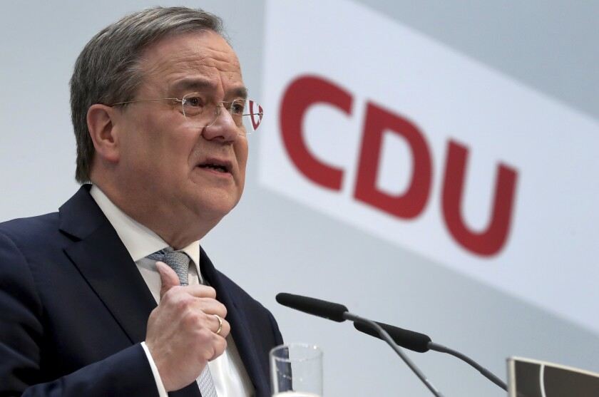 Armin Laschet, chairman of the German Christian Democratic Union, CDU, addresses the media during a press conference at the party's headquarters in Berlin, Germany, Monday, March 15, 2021 the day after the regional elections in the German states of Baden-Wuerttemberg and Rhineland-Palatinate. Chancellor Angela Merkel's party CDU is considering how to respond to historically bad state election results six months before a national vote that will determine who succeeds Germany's long-time leader. (AP Photo/Michael Sohn, pool)