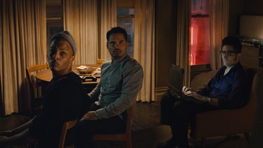 """Dave (T.I.), left, Luis (Michael Peña) and Kurt (David Dastmalchian) appear in a scene from """"Ant-Man."""""""