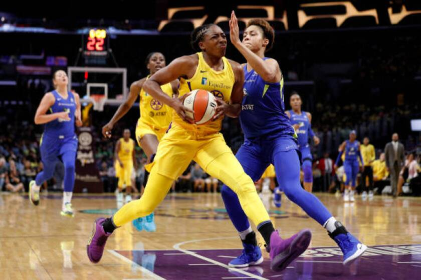 Sparks forward Nneka Ogwumike drives to the basket during a game against the Dallas Wings.