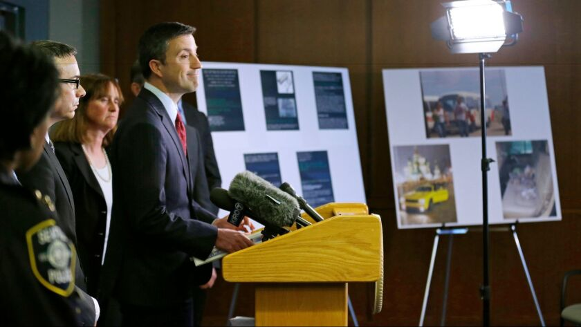 Trevor McFadden acting principal deputy assistant attorney general, smiles as he talks to, Friday, A
