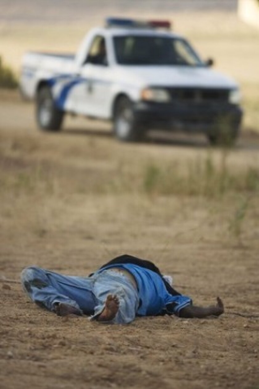 A homicide victim recently on the outskirts of Tijuana, Mexico. Critics dismiss the attorney general's argument as so much spin.