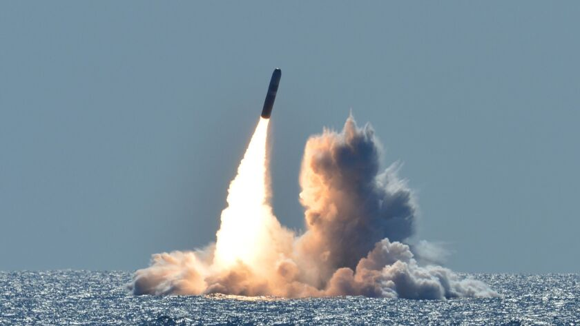 An unarmed Trident II D5 missile launches from the Ohio-class ballistic missile submarine USS Nebraska (SSBN 739) off the coast of California in 2008.