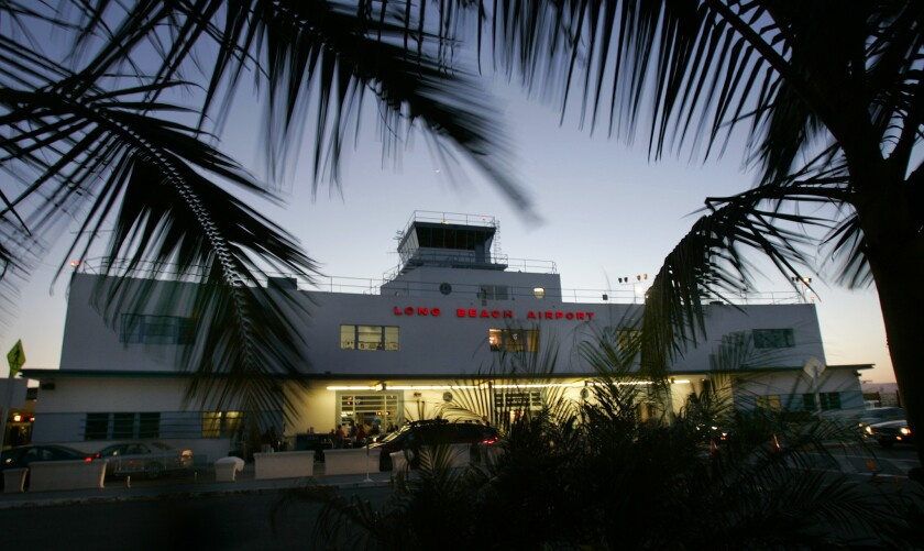 ––––Passengers arrive at Long Beach Airport, where JetBlue, the facility's main carrier, had sought to add flights to Latin America.