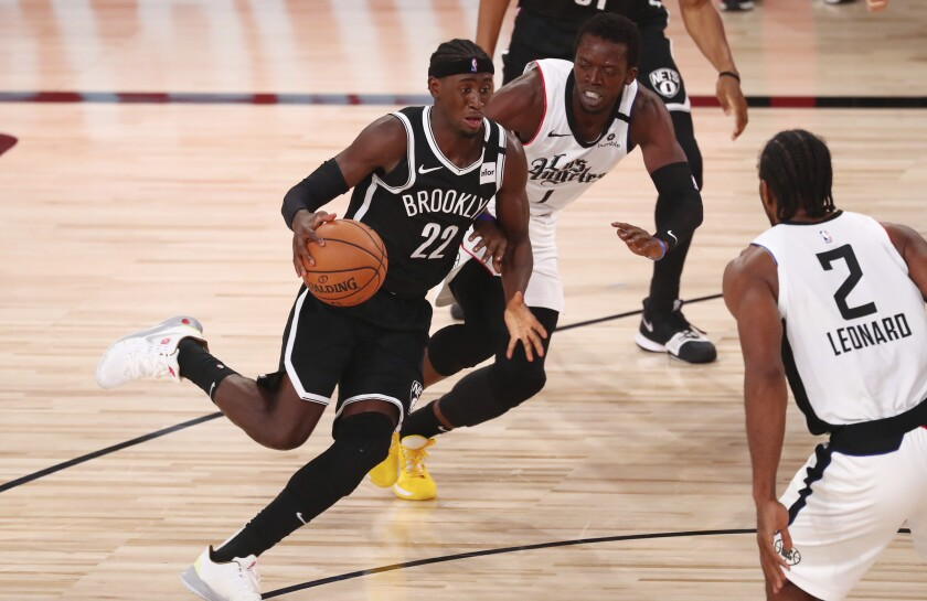 Brooklyn Nets guard Caris LeVert (22) dribbles the ball against Los Angeles Clippers guard Reggie Jackson (1) in the first half of an NBA basketball game Sunday, Aug. 9, 2020, in Lake Buena Vista, Fla. (Kim Klement/Pool Photo via AP)