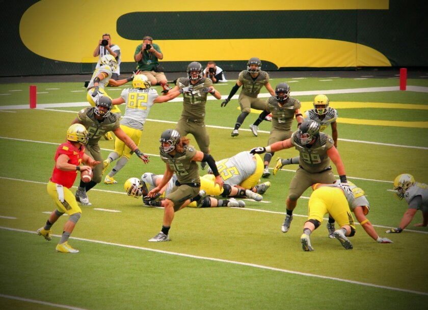 Jake Rodrigues stares down the Ducks' defense in Oregon's spring game in May.
