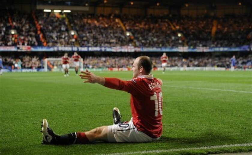 Manchester United's Wayne Rooney celebrates his goal during the Champions League Group F soccer match between Chelsea and Manchester United at Stamford Bridge stadium in London, Wednesday, April 6, 2011. (AP Photo/Tom Hevezi)