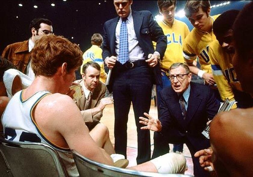 Wooden delivers instructions during a timeout in the 1972 NCAA championship game at the L.A. Sports Arena. UCLA defeated Florida State, 81-76; Bill Walton, seated at left, was named the tournament's most outstanding player.