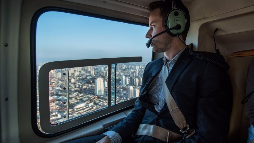 A Brazilian businessman flies over São Paulo, Brazil. Helicopter services offer an alternative to São Paulo's heavy car traffic. Could air taxis be developed to operate like Uber rides?