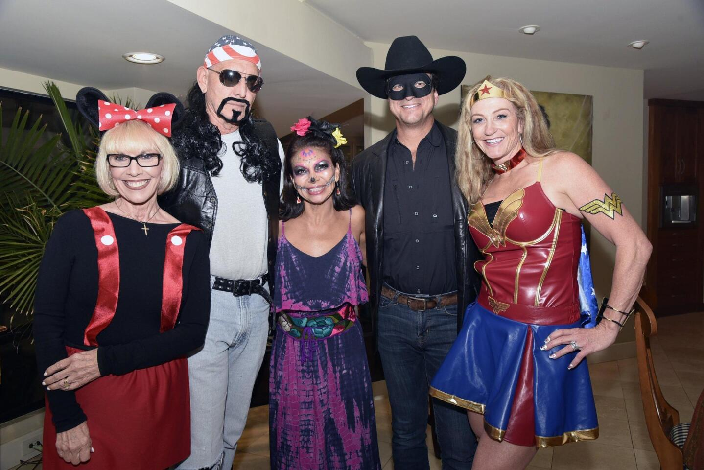 Rotary Assistant Governor Susan Callahan, Rotary President/Most Out of Character costume winner Mike Taylor, Angelica Rodriguez, Chris and Denise Korenek