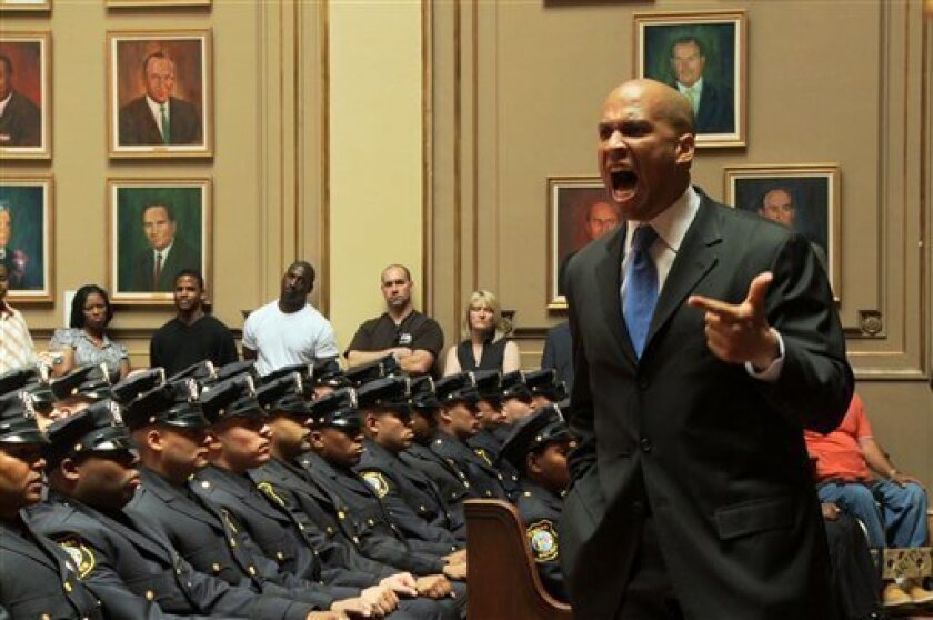 """In this TV publicity image released by the Sundance Channel, Newark Mayor Cory Booker speaks at a Newark Police Academy graduation ceremony in a scene from the documentary series, """"Brick City,"""" airing Monday, Sept. 21, 2009 thru Friday on the Sundance Channel. (AP Photo/Sundance Channel)"""
