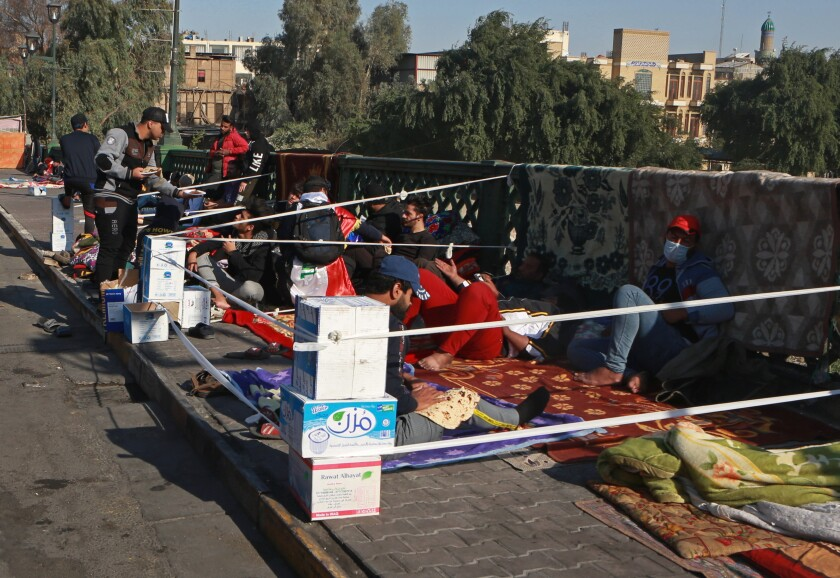Antigovernment protesters stage a sit-in Nov. 20 on the Ahrar Bridge in Baghdad.