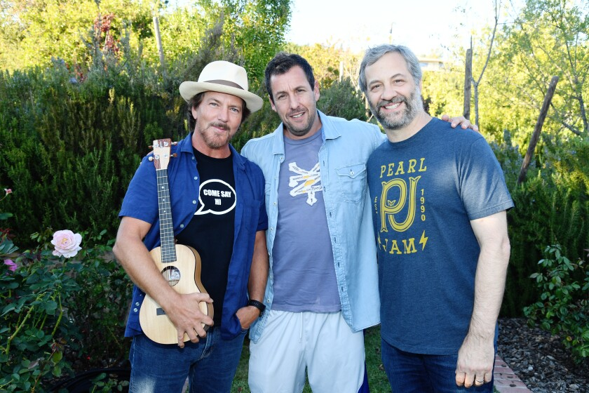 Eddie Vedder, left, Adam Sandler and Judd Apatow attend the Rock4EB! event at the home of Marc Gurvitz of Brillstein Entertainment Partners in Malibu on Sunday.