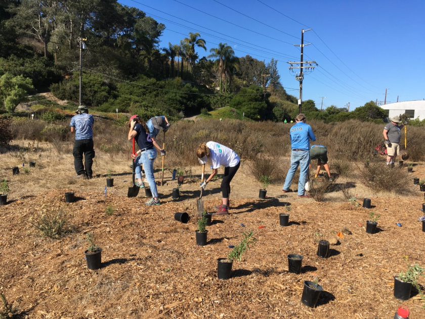 Volunteers work on River Path Del Mar.