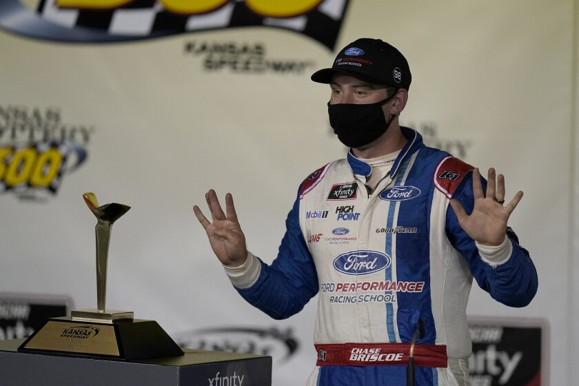 Chase Briscoe celebrates in victory lane following a NASCAR Xfinity Series auto race at Kansas Speedway in Kansas City, Kan., Saturday, Oct. 17, 2020. (AP Photo/Orlin Wagner)