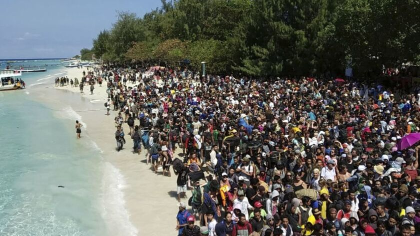 In this photo released by the Indonesian Marine Police, tourists affected by a strong earthquake lin