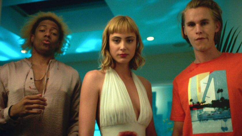 """(L-R)- Nick Cannon, Nora Arnezeder, and Rhys Wakefield in a scene from """"Berserk."""" Credit: Freestyle"""