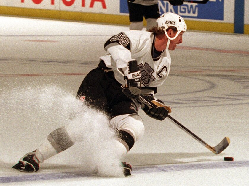 Kings great Wayne Gretzky cuts back while controlling the puck during a game against the Vancouver Canucks at the Forum in 1995.