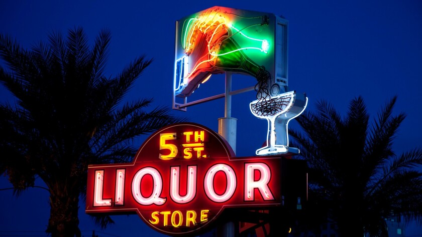 The colorful sign that once adorned a downtown liquor store is now part of the public display of neo