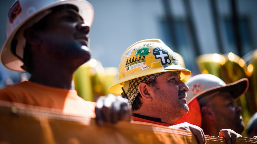 VAN NUYS, CA - Andrew Nesbeth, left, and Jose Gonzalez of Local 300 Laborers take part in a rally i