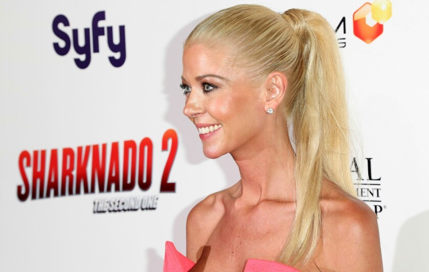 """At a night of bowling with Blue Shield executive Aaron Kaufman, """"Sharknado"""" actress Tara Reid """"acted inappropriately, taking inappropriate photographs of herself and sharing them,"""" the company said in court documents."""