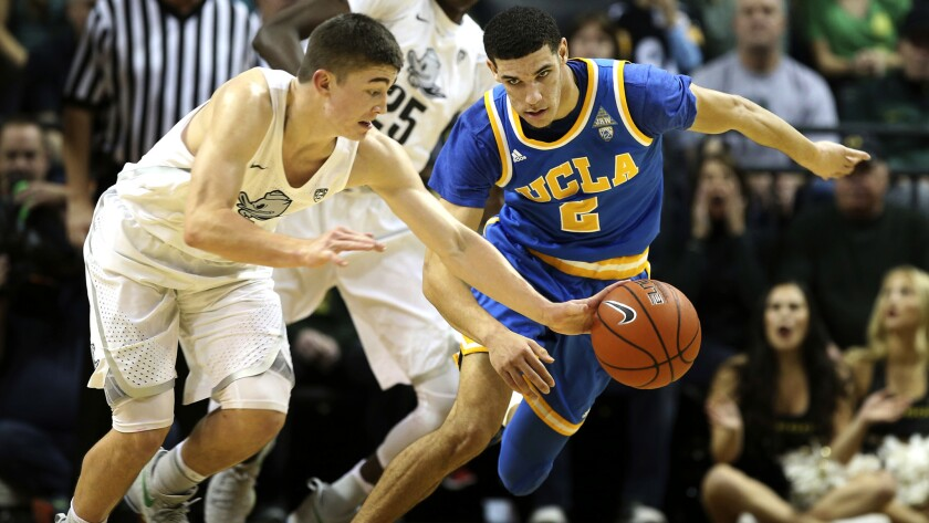 Oregon's Payton Pritchard forces a turnover by UCLA's Lonzo Ball during the first half Wednesday night.