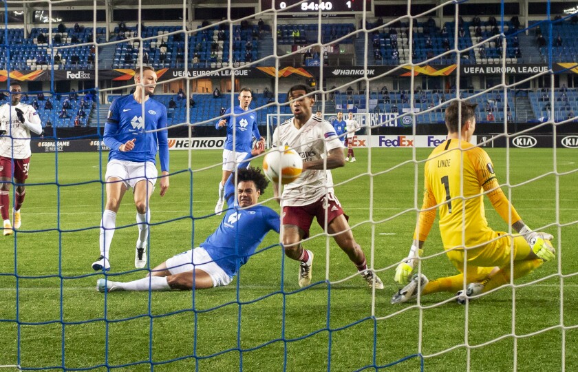 Arsenal's Reiss Nelson scores to take the score to 0-2 against Molde, during the Europa League Group stage Group B, soccer match between Molde and Arsenal at Aker Stadium in Molde, Norway, Thursday Nov. 26, 2020. (Svein Ove Ekornesvag / NTB via AP)