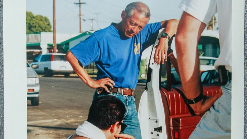 A Union-Tribune file photo shows Sgt. Ruben Sandoval working the streets of Oceanside with the gang unit in the mid-1990s.