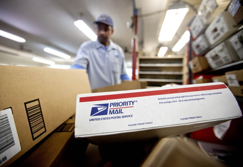 The U.S. Postal Service on Friday reported its seventh-straight net yearly loss. The agency said it lost $5 billion in the last fiscal year in spite of improved revenue and productivity. Above, packages wait to be sorted in Atlanta in February.