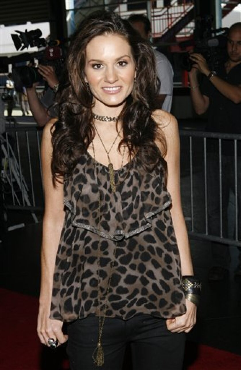 """In this Aug. 26, 2008 file photo, Kara DioGuardi, the newest judge on """"American Idol"""", arrives at a promotional event for the show in New York. DioGuardi has a full schedule but there's someone she'd take a phone call from _ Chris Daughtry. (AP Photo/Jason DeCrow, file)"""