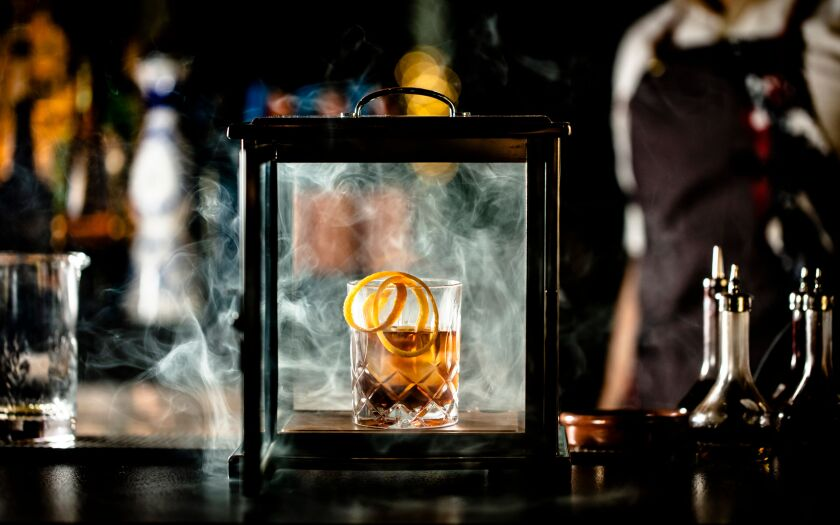 Even the cocktails get the smoke treatment at International Smoke. The $25 specialty Smoke Signals concocation is a twist on an old fashioned, made with Basil Hayden's bourbon, homemade cardamom syrup and mole-like corazón bitters.