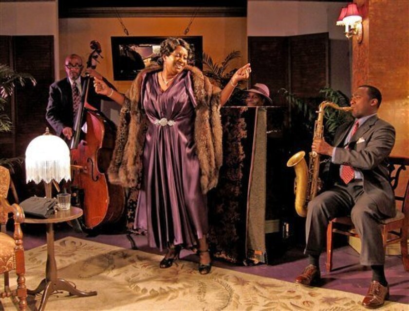 """In this theater publicity photo released by David Gersten & Associates, from left, Jim Hankins (bass), Miche Braden (as Bessie Smith), Aaron Graves (piano), and Keith Loftis (saxophone), are shown in a scene from """"The Devil's Music: The Life And Blues Of Bessie Smith,"""" performing off-Broadway at St. Luke's Theatre in New York. (AP Photo/David Gersten & Associates, John Quilty)"""