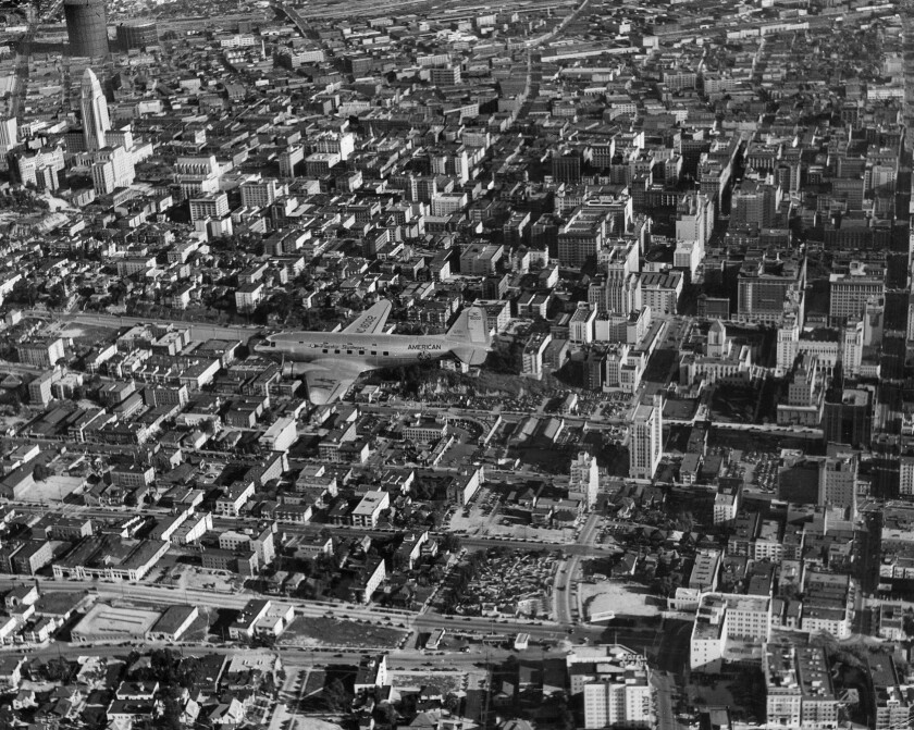 American Airlines DC-3 photographed flying over downtown Los Angeles in 1940.