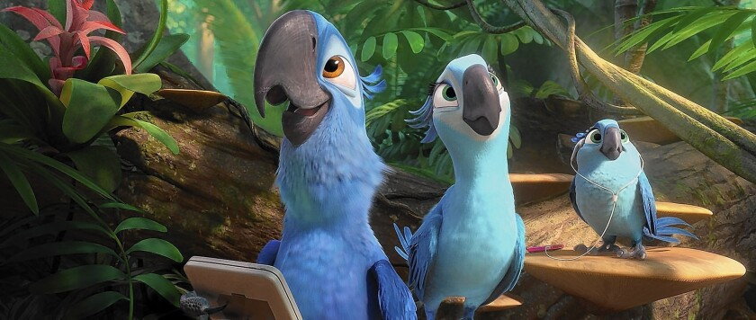"Blu (Jesse Eisenberg), Jewel (Anne Hathaway) and their music-loving daughter, Carla (Rachel Crow), enjoy the exotic sounds of the jungle in ""Rio 2."""