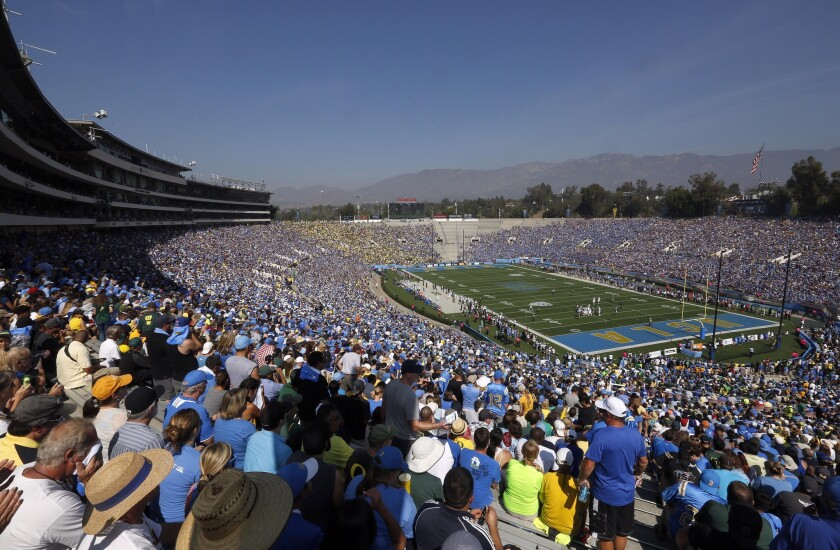 Fans watch UCLA take on Oregon at the Rose Bowl on Oct. 11, 2014.