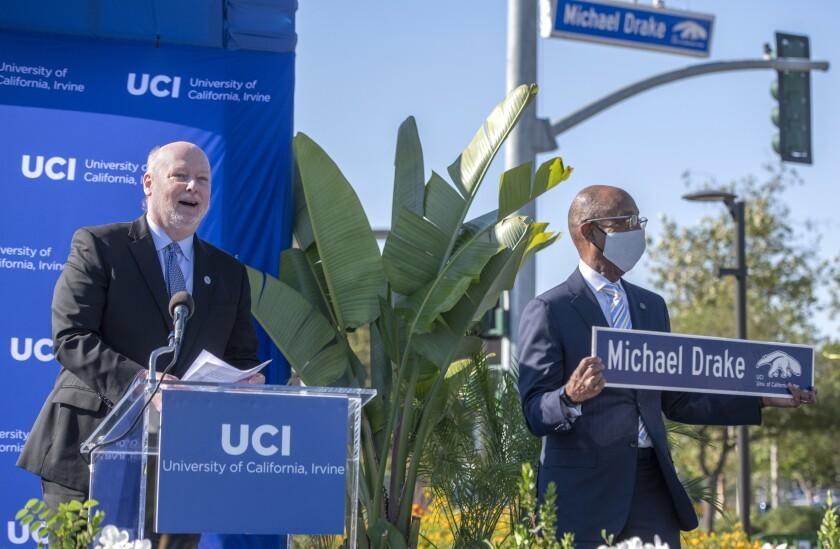 UCI Chancellor Howard Gillman, left, speaks alongside UC President Michael Drake