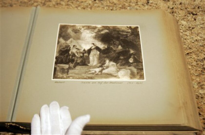 """This photo taken on Dec. 2, 2009 in Dallas shows a page from a lost album that once belonged to Adolf Hitler, part of a series compiled for Hitler featuring photographs of art he wanted for his """"Fuehrermuseum,"""" a planned museum in Linz, Austria. The book, taken by U.S. serviceman  John Pistone  dur"""
