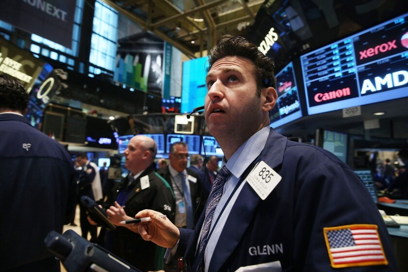 """High levels of cortisol, the stress hormone, may contribute to the risk aversion and """"irrational pessimism"""" found among bankers and fund managers during financial crises, according to a new study. The photo shows the New York Stock Exchange."""