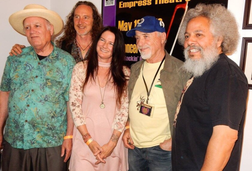 The current members of Big Brother & The Holding Company are, from left, bassist  Peter Albin, guitarist Tom Finch, lead singer Darby Gould, drummer Dave Getz and guitarist  David Aguilar. Getz and Albin are original members of the band, whose debut album came out in 1967.