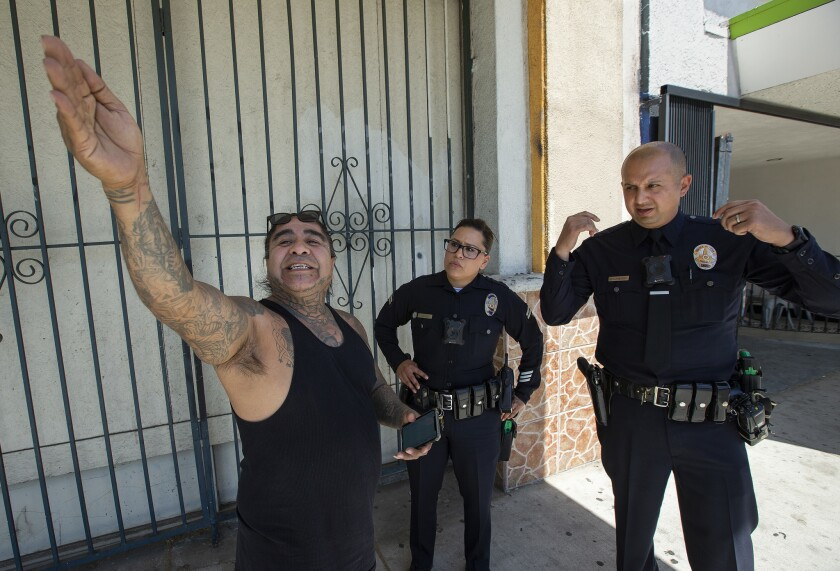 RESEDA, CA-APRIL 24, 2019: Tattoo shop owner Edward Everett, left, points out where cars have recen
