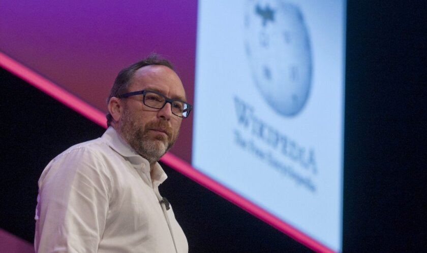 Wikipedia founder Jimmy Wales speaks at a conference.