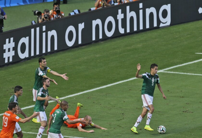 Mexico's Rafael Marquez, left, gestures after fouling Netherlands' Arjen Robben inside the penalty zone during the World Cup round of 16 soccer match between the Netherlands and Mexico at the Arena Castelao in Fortaleza, Brazil, Sunday, June 29, 2014. (AP Photo/Themba Hadebe)