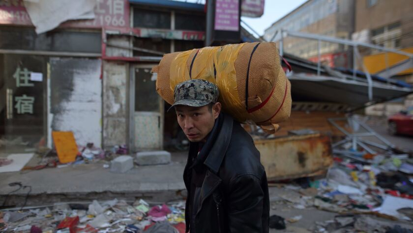 Chinese migrant workers are required to move out of their rental houses in Beijing, China - 24 Nov 2017