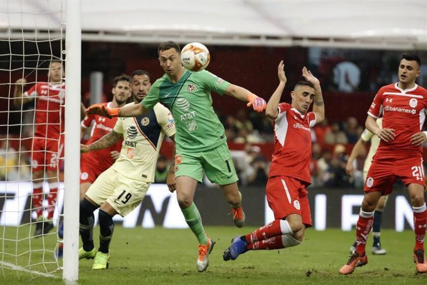 America goalkeeper Agustin Marchesin (L) makes a play for the ball against Toluca's Osvaldo Gonzalez (R) during the Liga MX match played on Nov. 3, 2018, at Azteca Stadium in Mexico City, Mexico. EPA-EFE FILE/Jose Mendez