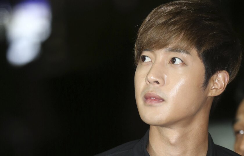 In this Sept. 2, 2014 photo, South Korean singer and actor Kim Hyun-joong arrives at the Gangnam police station in Seoul, South Korea. Police said Kim has acknowledged that he hit his then-girlfriend during an argument in May at his home in Seoul. (AP Photo/Yang Ji-woong, Yonhap) KOREA OUT