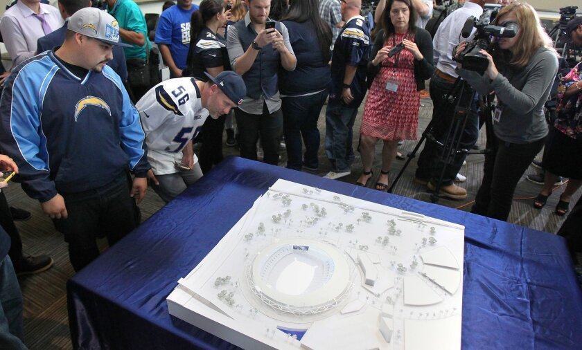 The Stadium Advisory Council unveiled its proposal for a new Chargers Stadium to be located near the sit of the current Qualcomm Stadium. The press conference was held at The San Diego County Operations Center in Kearny Mesa. Chargers fans came up to view the scale model after the press conference. Photo by John Gastaldo/U-T San Diego/Zuma Press