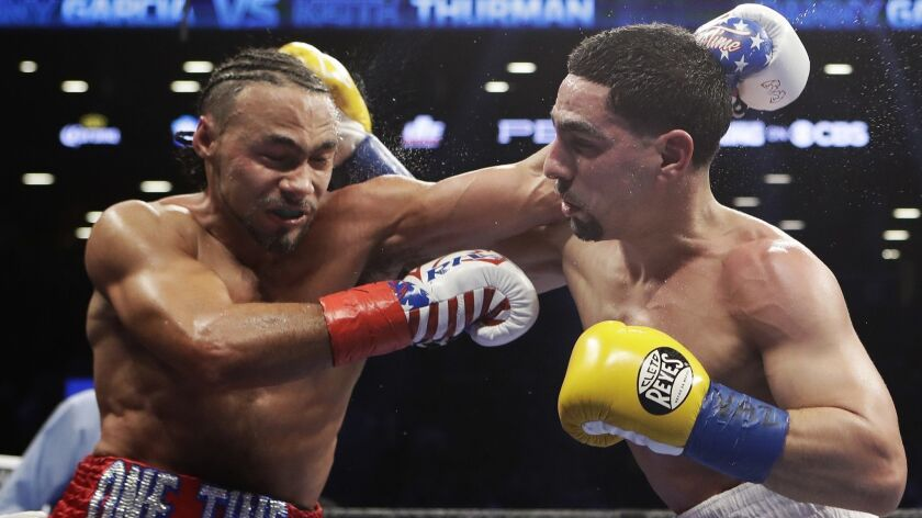 Keith Thurman, left, fights Danny Garcia during the fifth round of a welterweight championship boxing match in March 2017.
